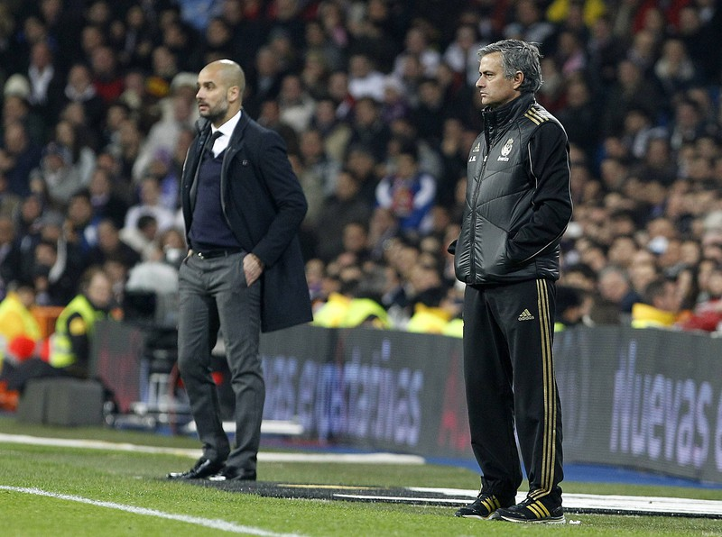 Das Bild illustriert Pep Guardiola und Jose Morinho, die zu den bestbezahltesten Trainer weltweit gehören