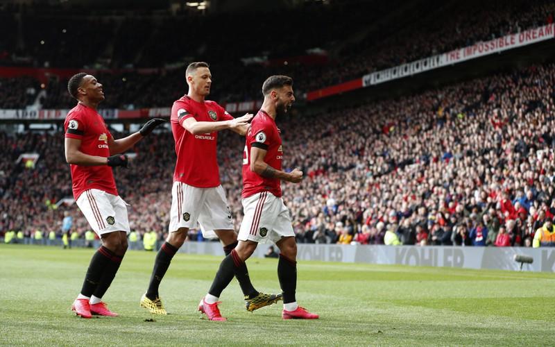 Das Bild illustriert Manchester United, die knapp 712 Millionen Euro Umsatz machen